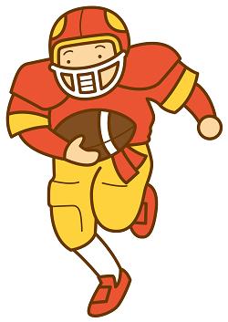 アメフト選手がボールを持って走っている画像