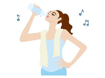 トレーニングの合間に水分を摂取している女性の画像